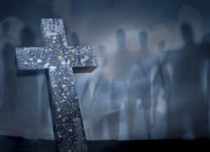 ghosts walking by grave with cross in fog