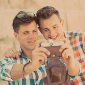 A gay couple taking a selfie together