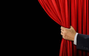 hand holding curtain open