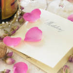 wedding invitation with flower petals on it