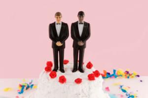 Two groom figures on a wedding cake