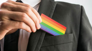 man holding rainbow business card