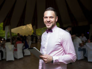 A wedding emcee with tablet
