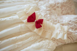 A wedding dress and garter waiting for reveal
