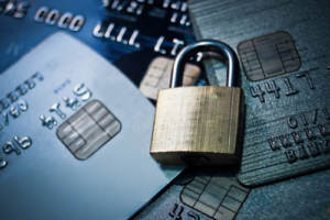 A padlock resting on credit cards indicating identity security