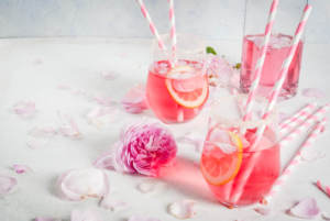 A signature wedding day cocktail with rose petals