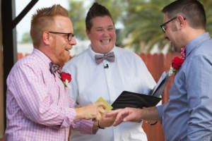 A newlywed couple with a friend to officiate