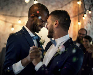 A newlywed couple sharing their first dance
