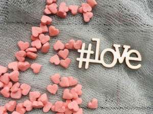 A wedding hashtag with candy hearts