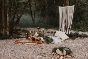 A rocky riverbank with decorations; a popular venue for eloping couples
