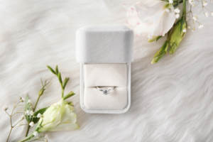 A well-maintained engagement ring in a white presentation box