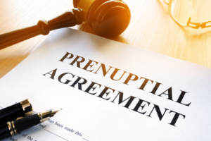 A prenuptial agreement on a table with pen and gavel
